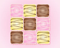 Fancy cakes. An illustration of french fancy cakes in pink yellow and chocolate icing with paper bun cases on a pink background Royalty Free Stock Images