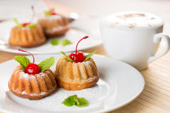 Fancy cakes dessert with cappuccino coffee. On table Stock Photography