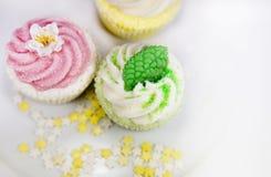Fancy cakes with vanilla sticks on white Stock Photo