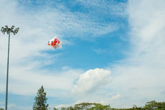 Fancy carp fish shaped kite flying in blue cloudy sky Royalty Free Stock Images
