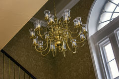 Fancy chandelier in old estate house Stock Photos