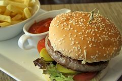 Fancy cheeseburger. With french fries served in restaurant Stock Photo