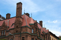 Fancy chimney. Fancy ornate chimney on red roof of old brownstone along commonwealth avenue in boston massachusetts Royalty Free Stock Image