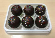 Fancy chocolate cake ball in white tray Royalty Free Stock Images