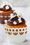 Fancy chocolate cupcakes on wooden table. Party dish Stock Photography