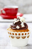 Fancy chocolate cupcakes on wooden table. Party dish Royalty Free Stock Photos