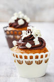 Fancy chocolate cupcakes on wooden table. Party dish Stock Images
