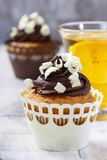Fancy chocolate cupcakes on wooden table. Festive and party dessert Royalty Free Stock Photography
