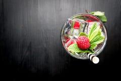 Raspberry martini cosmopolitan cocktail drink. Fancy cocktail alcohol beverage drink fresh mint raspberry vodka gin ice cubes bar restaurant hotel bartender royalty free stock photo