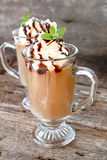 Fancy Coffee. Two latte's with whipped topping and chocolate syrup and garnished with fresh mint leaves Stock Image