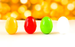 Fancy or colorful of egg in yellow bokeh light background. soft Royalty Free Stock Photo