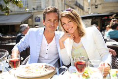 Fancy couple in a fancy restaurant eating lunch and drinking wine Stock Photo