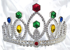 Fancy Crown. A crown for a fancy princess on a satin background Royalty Free Stock Photos