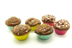 Fancy cupcakes. On a white background Royalty Free Stock Photo
