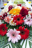 Fancy Daisy Display. Colorful Gerber daisies in a floral arrangement at a film set wedding Royalty Free Stock Images