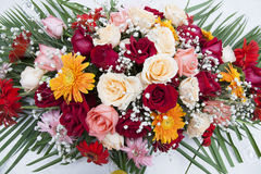 Fancy Daisy and Rose Display. Colorful Gerber daisies and roses in a floral arrangement at a film set wedding Stock Photography