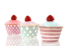 Fancy decorative cakes. With cherry on top Royalty Free Stock Image