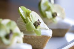 Fancy Desserts. Financiers or Friands and Meringue with Orchids Stock Photos