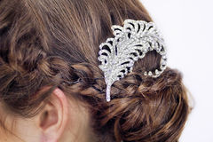 Fancy diamond brooch in brunette's hair. stock images