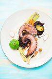Fancy dinner with octopus, vegetables and black rice Stock Photos