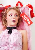 Fancy doll with sale tag Royalty Free Stock Image