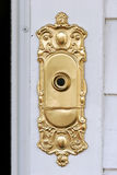 Fancy doorbell. Fancy gilt doorbell plate on a wall royalty free stock images