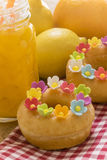 Fancy Doughnuts. Close up of tasty donuts on wooden table Royalty Free Stock Images