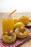 Fancy Doughnuts. Colorful donuts and orange juice on wooden table Stock Photography