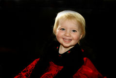 Fancy dress. Blond child wearing fancy dress against black background closeup Royalty Free Stock Photo