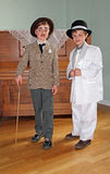 1920 fancy dress kids. Photo of two kids at a 1920 fancy dress party disguised as al capone and charlie chaplin in kent on 4th april 2014.photo ideal for vintage Stock Images