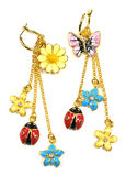 Fancy Earring. Beautiful and fancy earring dangler, funny earbob with flower and insect Stock Photography