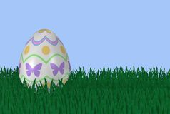 Fancy Easter Egg in Grass Stock Photo