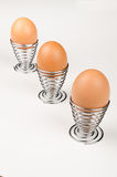 Fancy egg cups. Hardboiled eggs in fancy egg cups Stock Photos
