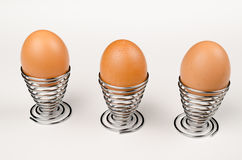 Fancy egg cups. Hardboiled eggs in fancy egg cups Stock Photo