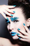 Fancy eyebrows. Portrait of young beautiful woman with fancy feather eyebrows and dot manicure royalty free stock image