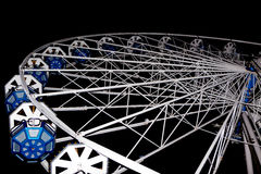 Fancy Fair wheel night. A white and blue wheel at the fancy fair against the black sky of the night Stock Photo