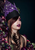 Fancy Fashion Model in Theatrical Colorful Hat Royalty Free Stock Photography