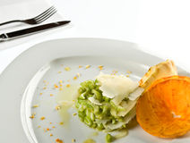 Fancy Food Display. Ed on a white plate with silverware royalty free stock photography