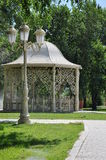 Fancy gazebo in a park. Beautiful gazebo in a park surrounded by trees and grass Royalty Free Stock Image
