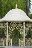 Fancy gazebo in a park. Beautiful gazebo in a park surrounded by trees and grass Stock Photos