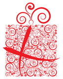 Fancy Gift. Red fancy gift wrapped in floral, hearts, and swirl design Stock Photos