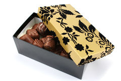 Fancy Gift Box and Chocolates. Fancy black and gold gift box with handmade chocolates royalty free stock photography