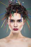 Fancy girl with needles in hair Stock Photo