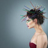 Fancy girl with needles in hair Stock Photos