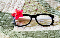 Fancy glasses on a blanket Royalty Free Stock Photography