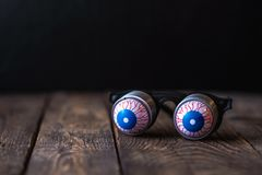 Glasses with eyeballs on springs royalty free stock photography
