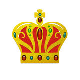 Fancy gold crown with inlaid jewels of ruby emerald and sapphires with red velvet cloth and gold cross on top Stock Photos