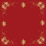 Fancy Gold Snowflakes on Red Holiday Accent Tile Stock Photo