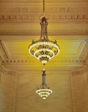 Fancy golden chandeliers Stock Photography
