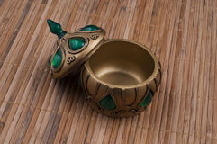 Fancy handmade box. On the bamboo background Royalty Free Stock Photos